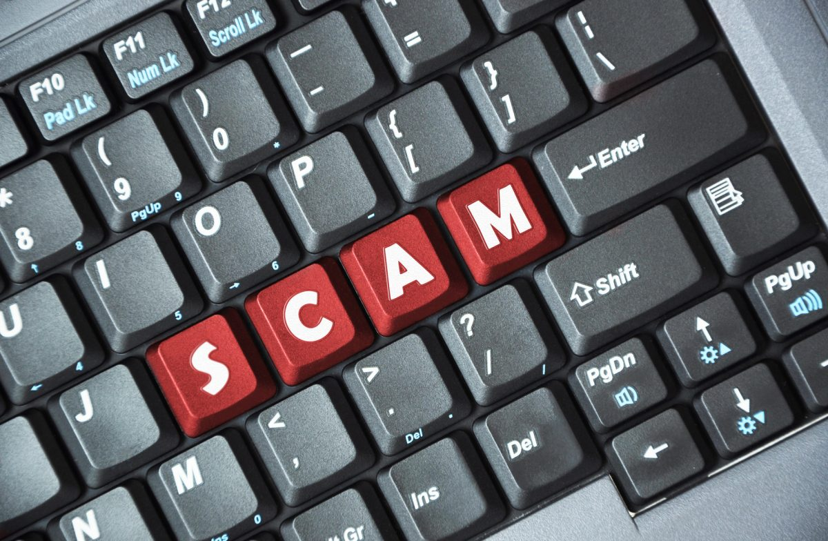 Lottery Scams - scam on keyboard