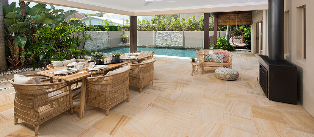 Outdoor dining area and swimming pool.
