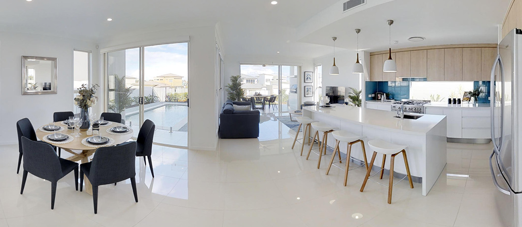 Modern open plan kitchen, living and dining with pool and backyard views.