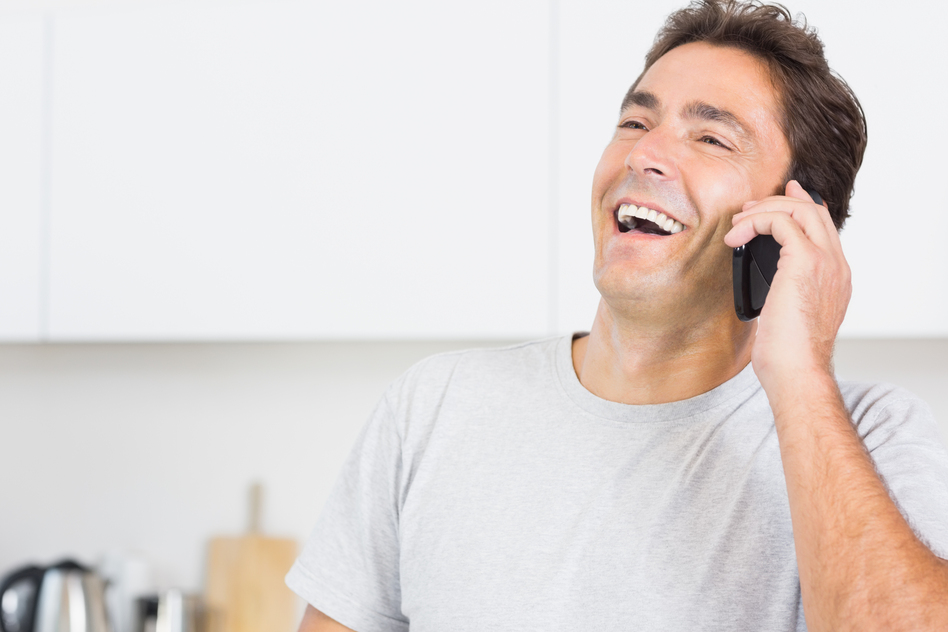 Man laughing on his phone.