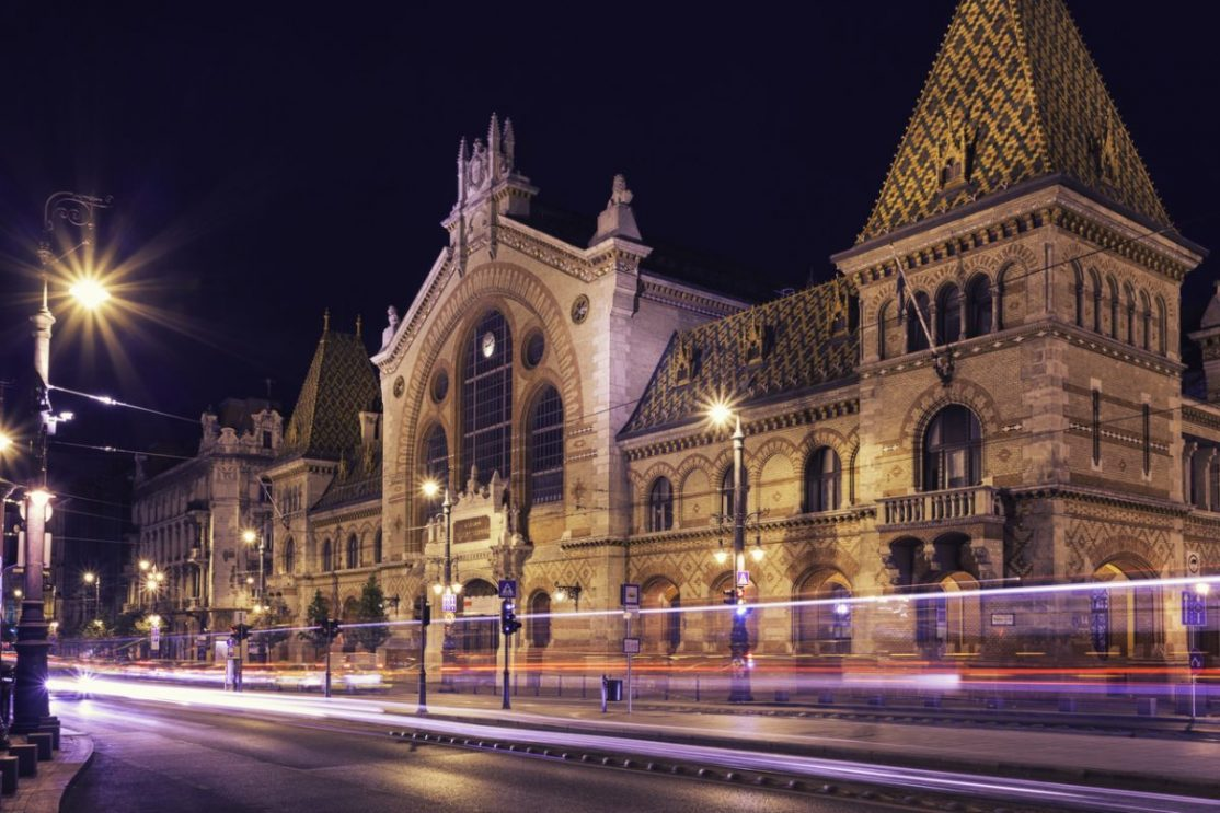 The Great Market Hall in Budapest at night.