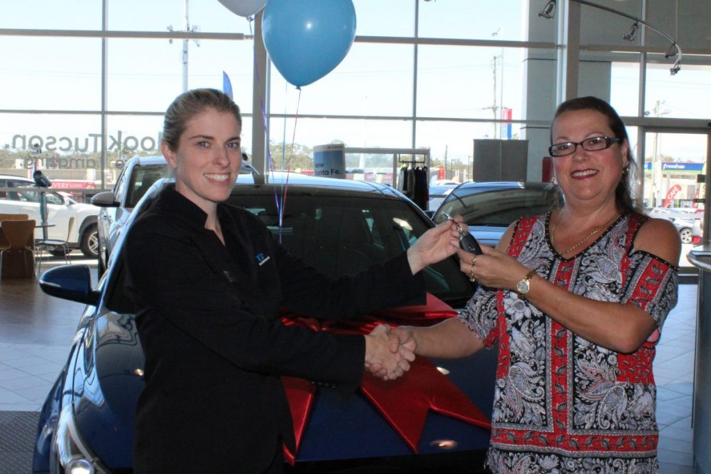 Lottery 173 Winner collecting the keys to her new car!