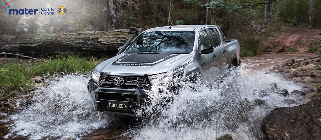Toyota Hilux Rugged X in water.