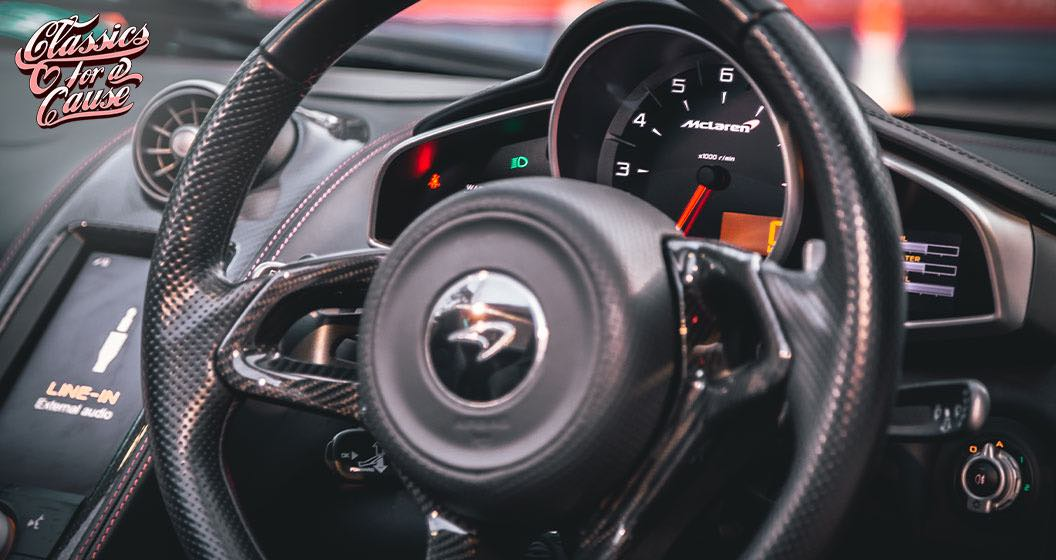 Classics for a Cause interior view of steering wheel.