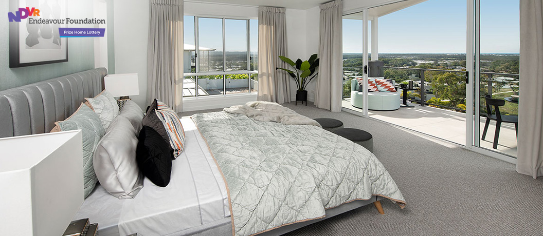 Prize Home bedroom with balcony views.