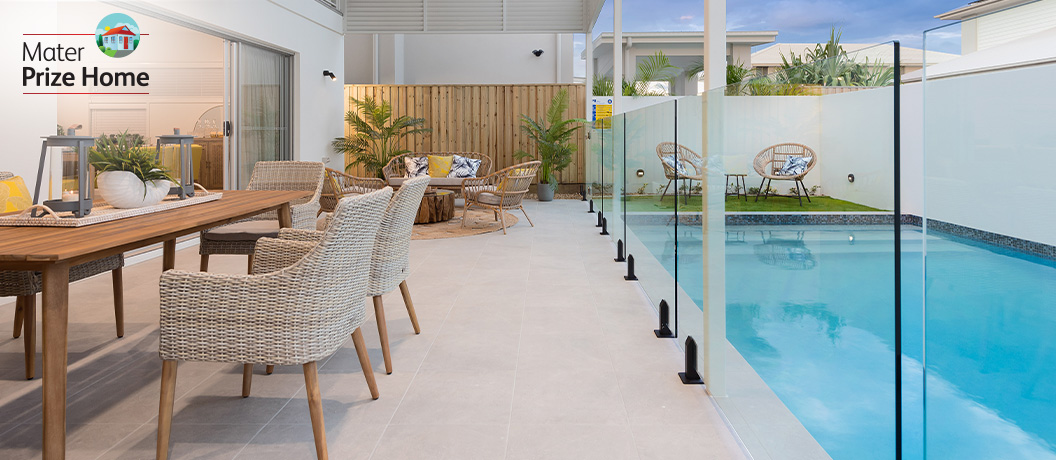 Prize Home draw 291 - outdoor dining and pool view.